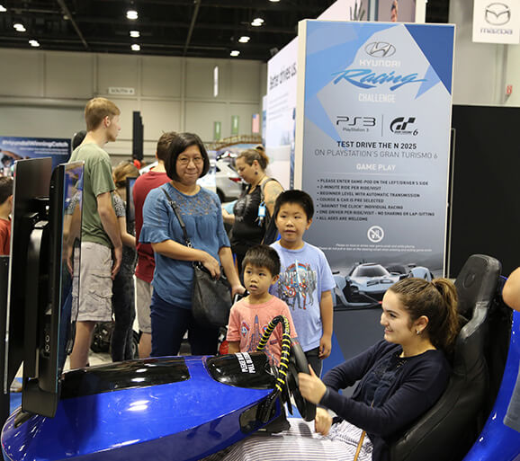 Girl test drives the driving simulator